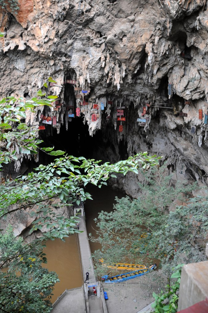 Prayers hung high in the air above Swallow Cave